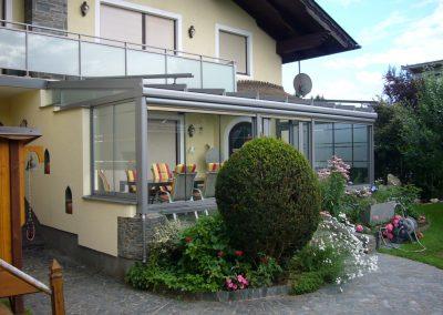 Terrassenüberglasung mit Rahmenfreien Schiebeelementen und Sonnenschutz